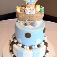 Noah's Ark Baby Shower Cake Buttercream iced cake with brown, blue, & white fondant stripes and polka dots. Ark is made of rice krispy treats and fondant. Animals...