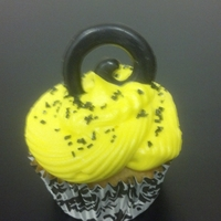 Black & Yellow Black & yellow buttercream iced cupcakes with molded chocolate swirl topper.