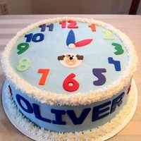 Toddler Clock Birthday Cake Buttercream iced clock cake with fondant decorations for a 2 yr old's birthday. He is obsessed with numbers and clocks and loves dogs...