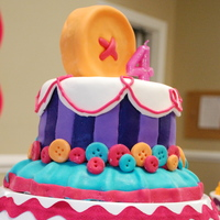 "Lalaloopsy Birthday Cake three tiered Lalaloopsy inspired birthday cakemolded button on top is 4"" cakeMMF covered and accents"