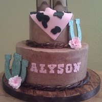 Country Themed Cake red velvet with chocolate swiss buttercream filling. boots, horseshoes, bandana all made from fondant.