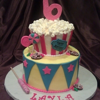 Layla's 6Th Birthday Circus Cake   buttercream with fondant accents, jellybeans, pretzels, and lolipops all fondant. Popcorn is marshmallows with petal dust. TFL