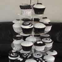 Black And White Wedding Cupcake Tower Fondant covered cupcakes, the crystal topper is also hand made by me. The cupcakes are vanilla filled with white chocolate ganache, and...