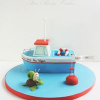 Captain Ron's Sea Wagon I made this little cake for a friend's Dad who was turning 60. Her dad likes boats, turtles and snails. The boat is carved from a...