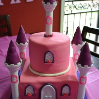 "Princess Castle This cake is 2-8"" square cakes on bottom and 2-6"" round cakes on top. Fondant covered and I used the Wilton castle kit for the..."