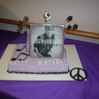 Justin Bieber Cake This is a two tier cake with a chocolate photo frame of an edible image of justin beiber