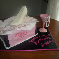 Shoe Box Cake fondant covered cake topped with a chocolate shoe