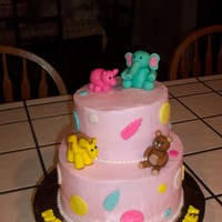 Baby Animals Shower Cake is b/c. Animals and decorations are fondant.