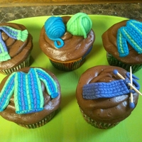 Knitted Cupcakes! Marzipan toppers. I made these using a tutorial video I found online.