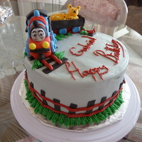 Thomas Train Strawberry cake with strawberry/buttercream filling covered with almond buttercream. Train and tracks made out of fondant mixed with...