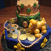 "Mardi Gras Birthday Cake Cake was ""Orange Creamsicle"" flavor with Vanilla Mousse filling and vanilla icing. Top ""crown"" was pastillage with..."