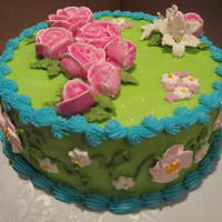 Pink And Green Roses This birthday cake for a friend was chocolate with buttercream icing. Flowers are royal icing. The pink and green color scheme was inspired...