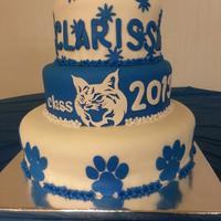 Bobcat Graduation Cake *this is a graduation cake i made for my niece. its a white and royal blue stripped cake with cream cheese filling.