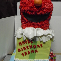 Elmo Cake  This cake was made out of Yellow cake with French Vanilla buttercreme....I thought I had done the right thing because I used a really long...