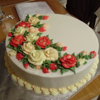 "Anniversary Roses 12"" round red velvet with cream cheese mousse filling and cream cheese buttercream, including the roses."