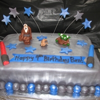 Star Wars Cake A birthday cake for my 9 year old's Star Wars themed birthday party. He and his 7 year old brother wanted to make the figures for the...