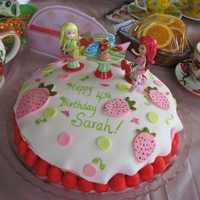"Strawberry Shortcake Tea Party Cake   MMF. Figures are bought. This was for a ""Strawberry Shortcake Tea Party"" for my 4 -year old's birthday."