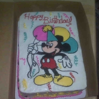 Mickey Mouse Cake   This was fun. This is a double layer 9x13 with a chocolate top layer and a vanilla bottom layer.