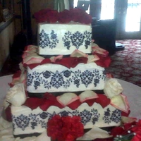 My First Wedding Cake  Black and white damask. The roses are real. Overall I'm happy, but I did have a bit of a scare when I arrived at the venue. Whew was...