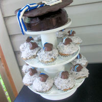 Graduation Cupcakes With Graduation Hat Cake for my brother's college graduation. cupcakes are cookies and cream with rolo and dove chocolate candy hats. Graduation hat topper is...