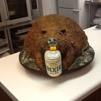 Nutria Groom's Cake The groom and friends go nutria hunting every year. The bride provided a photo of a nutria he killed and posed with a beer can. The cake...