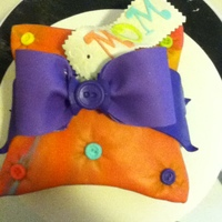 Mom's Pillow   marbled fondant gumpaste bow and name tag for my mom's birthday. she only wanted a small cake.