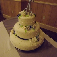 Summer Wedding Cake Three tier, round wedding cake. First and third tiers are vanilla cake with strawberry cream cheese filling. Middle tier is vanilla cake...