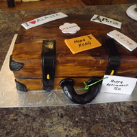 Fondant Suitcase Retirement Cake vanilla cake, chocolate ganache filling, mmf with fondant stickers and details. painted the fondant brown;.