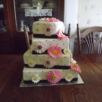 Four Tier, Square Wedding Cake white quilted fondant with white daisies, light pink and hot pink gerbera daisies