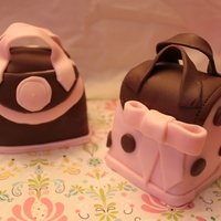 Mini Purse Cakes Mini Pink and brown purse cakes. My practice purse cake... my first ones...
