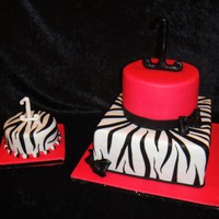 Zebra Print Cake Tres Leches cake pink with zewbra print. zebra print smash cake