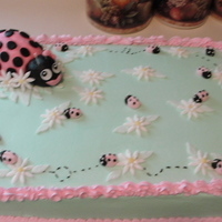 Ladybug Baby Shower Cake   strawberry cake with buttercream icing fondant ladybugs/and the daisy