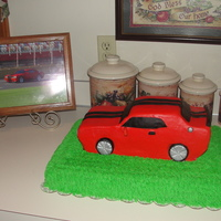 Car vanilla mocha cake with buttercream icing with fondant racing strips and accentsThanks for looking!