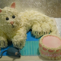 Kitty, Kitty  buttercream frosted kitty and mini cake, fondant mouse and 'quilt'. So much fun to do. Copied the birthday girl's favorite...