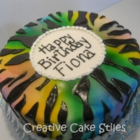 Rainbow Zebra   airbrushed fondant covered red velvet cake, and covered with black glitter gel painted zebra stripes