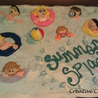 Summer Splash!   30 cupcakes pushed together with little swimmers. Heads rolled from fondant, everything else buttercream