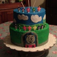 Thomas The Tank Engine 2 tier chocolate/vanilla butter almond cakes with a mix of buttercream and fondant decorations.