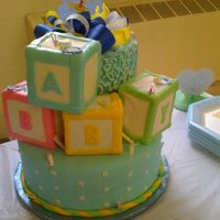 Baby Block Cake just a baby block cake. some minor mishaps with the fondant can be seen.
