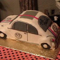 Herbie The Love Bug this is a grooms cake I made with marble cake and buttercream. Fondant decorations