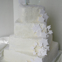 Snowflake Wedding Cake   Coated in sugar crystals to mimic snow. Gumpaste snowflakes. Spiral set tiers. https://www.facebook.com/sweettreatsbyjess