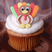 Thanksgiving Cupcake Pumpkin spice w/ cinnamon cream cheese icing. Topped w/ fondant turkey!