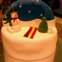 Christmas Globe  Bottom cake is 10 inch Carrot cake with cream cheese frosting and the top is a 10 inch while cut in half then carved to make a half top...