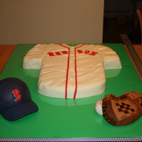 Baseball Cake The jersey is chocolate mud cake, the hat is lemon and the glove is rice crispies