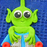 Alien Cupcake Topper Fondant 2D alien cupcake topper. Will be going on a pick to stand vertically on the cupcake.