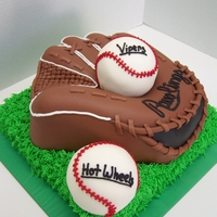 Ball & Glove Glove was made with a shaped pan & built up & carved from there. Baseballs were both cake covered in fondant.