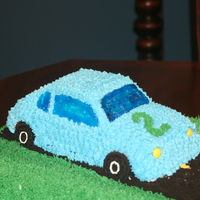 Car Cake I made this for my son's 2nd birthday. He has a passion for cars these days. It is the Wilton pan on top of a sheet cake. The windows...