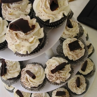 Cupcakes With Chocolate Curls   Chocolate cupcakes with Vanilla Swiss buttercream swirls and chocolate curls.