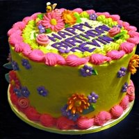 Colorful Flowers Birthday Cake   Chocolate cake with vanilla buttercream frosting. Fondant flowers.