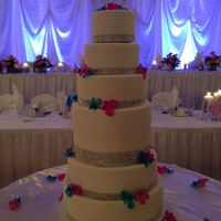 White Diamond Seven Tier Wedding Cake white fondant, diamond ribbon trim, preserved orchid flowers