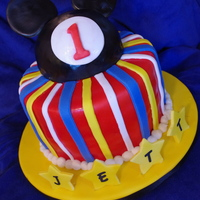 Mickey Mouse Cake this cake is double chocolate with raspberry filling and covered in fondant. The mickey mouse topper is made from rice krispie treats....